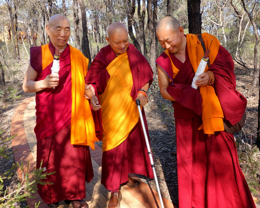 Geshe Doga and Geshe Wangchen leading Lama Zopa Rinpoche to the long life puja at the end of the retreat, Australia, October 23, 2014. Photo by Ven. Roger Kunsang.