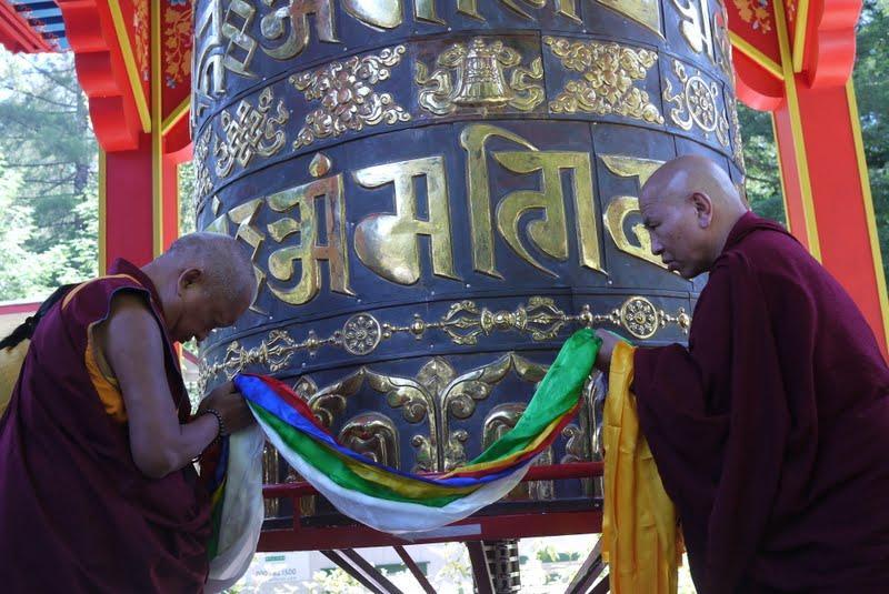 Lama Zopa Rinpoche consecrating the finished large prayer wheel at Land of Medicine Buddha.