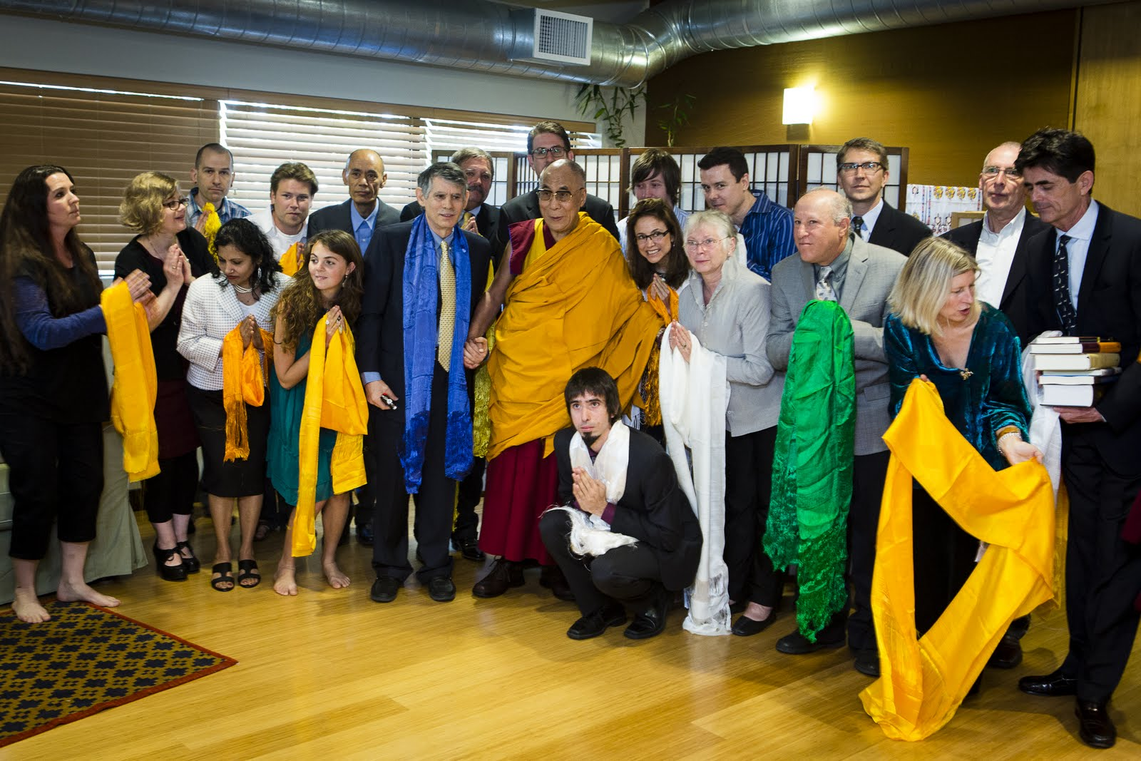 FPMT International Office Staff and present Board of Directors preparing for a photo opportunity with His Holiness the Dalai Lama. Photo by Leah Nash.