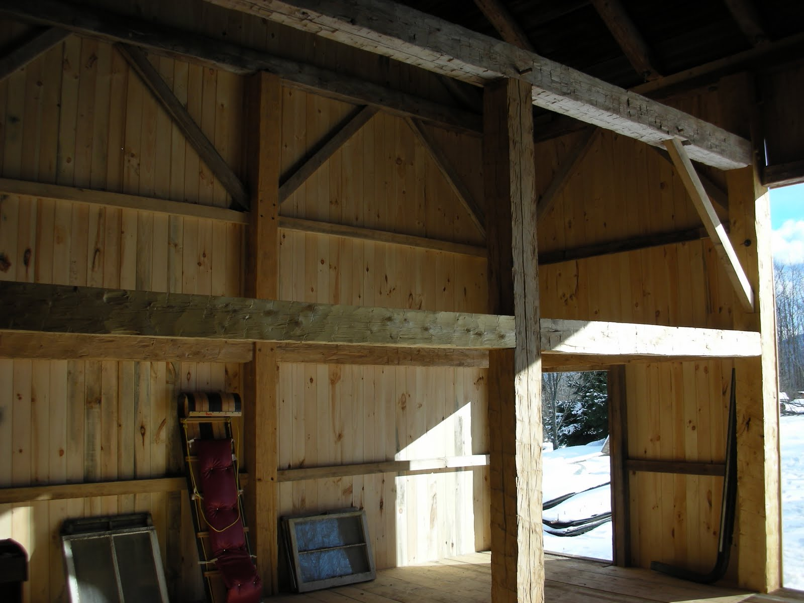 The gable wall is complete.  The bent in the foreground had the beech post replaced due to severe powder post beetle damage.  All of the posts and all but one of the girts that can be seen in this photo are new.