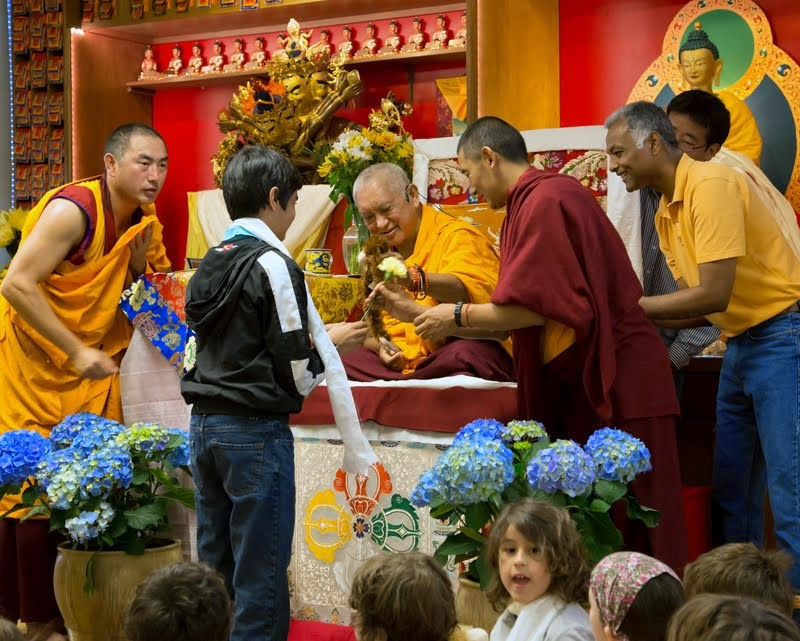 Lama Zopa Rinpoche and one of the youth of Kadampa Center, Raleigh, North Carolina, US, May 3, 2014. Photo by David Strevel.