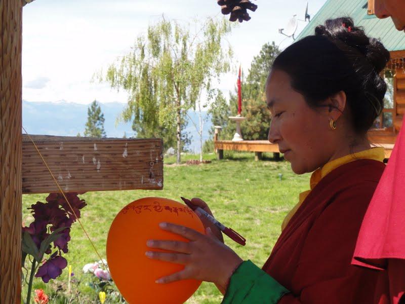 Khadro la writing mantras and prayers on balloon