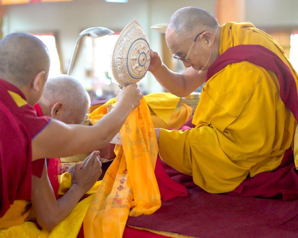 Lama Zopa Rinpoche offering Dharmachakra to His Holiness the Dalai Lama during Jangchub Lamrim teachings at Gaden Monastery, India, December 2014. Photo by Bill Kane.