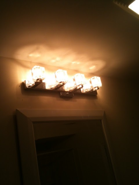 Jan 2012: New light fixture above vanity.