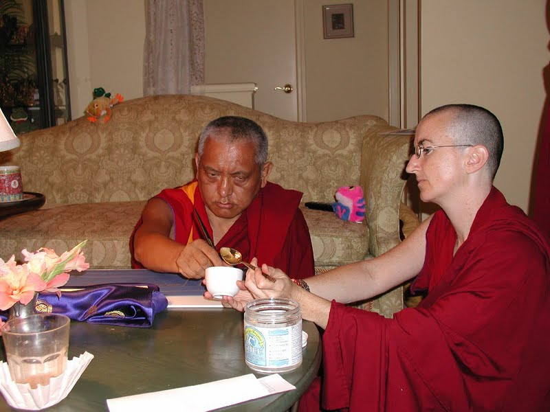 Lama Zopa Rinpoche writing the Sangatasutra in Deer Park, USA with the help of Ven.Damcho