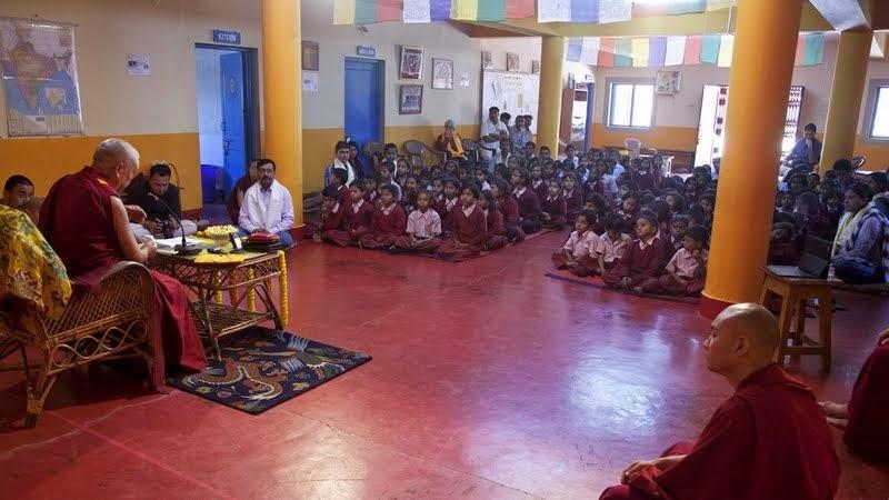 Lama Zopa Rinpoche teaching the children of Maitreya School and Tara Children's Home, Root Institute, Bodhgaya, India, March 2014. Photo by Andy Melnic.
