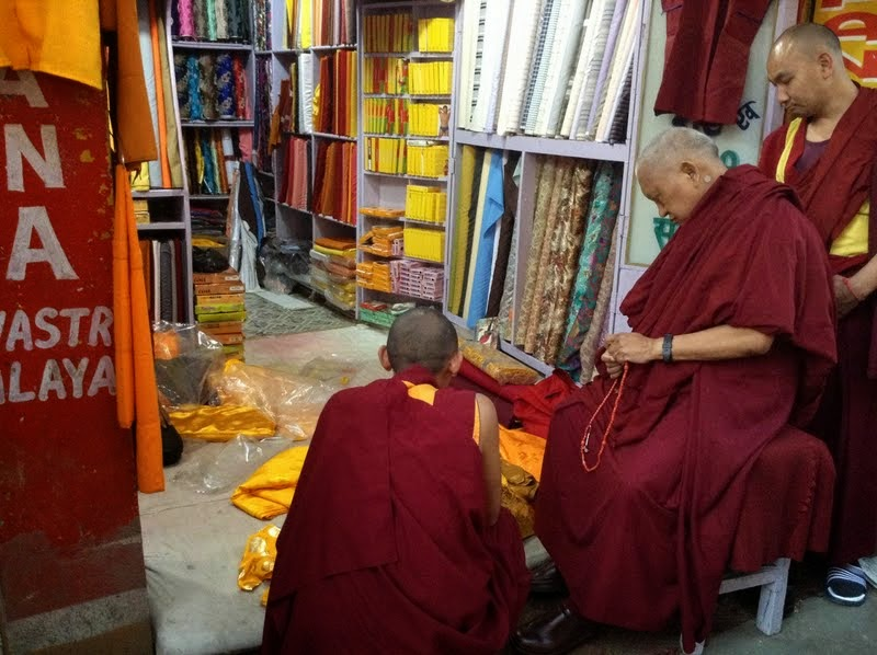 Every month Rinpoche sponsors the offering of robes to the Buddha statue inside the Mahabodhi Stupa through the Lama Zopa Rinpoche Bodhichitta Fund, Bodhgaya, India, February 2014. Photo by Ven. Sarah Thresher.
