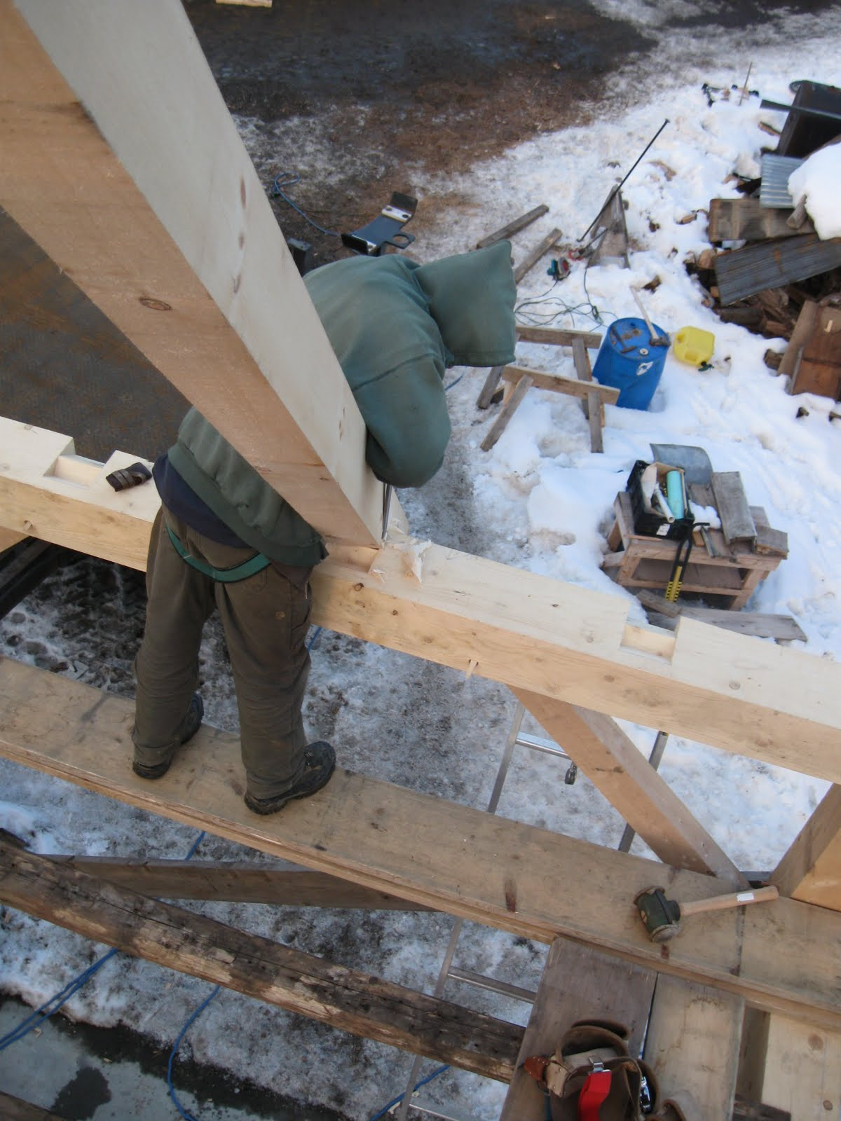 Michael shaves down a rafter before placing it in the step lap.