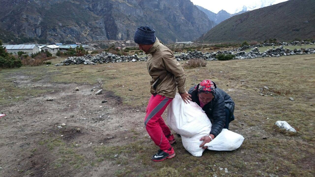 Residents with aid supplies in Solu Khumbu. Photo by Charok Lama.