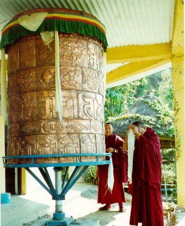 Lama Zopa Rinpoche offering a khata to a stupa in Pokhora, Nepal.