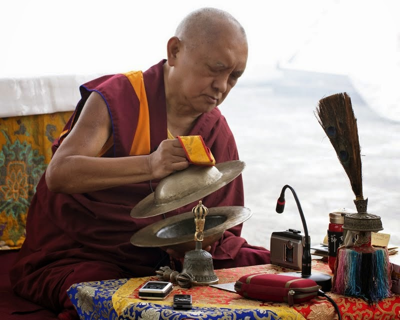 Lama Zopa Rinpoche playing cymbals, Root Institute, Bodhgaya, India, March 2014. Photo and video by Andy Melnic.