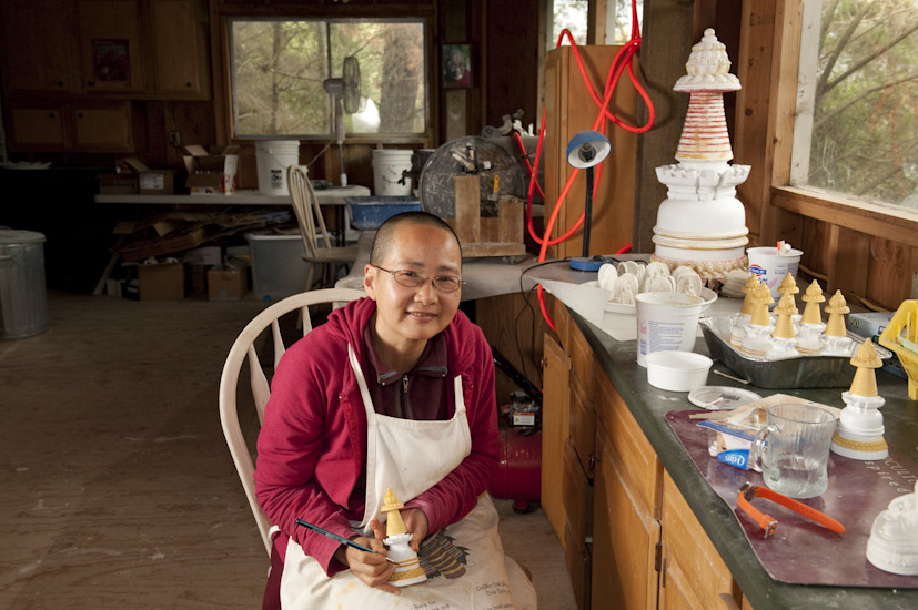 Ven. Chosang creating kadampa stupas at Lama Zopa Rinpoche's house. Photo by Whitney Dafoe.