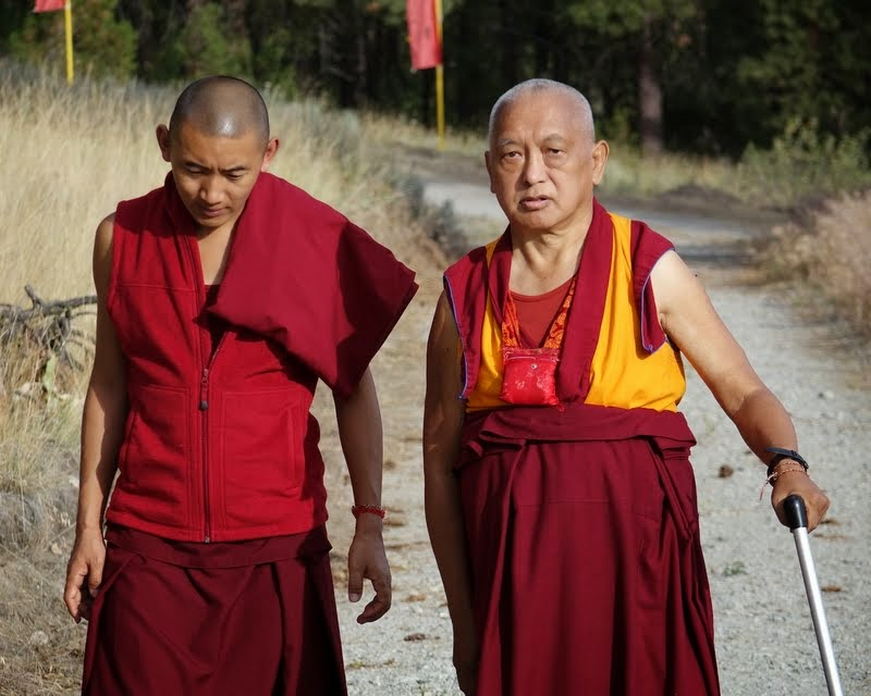 Lama Zopa Rinopche and Ven. Sangpo walk up to see the new Amitabha Buddha statue at Buddha Amitabha Pure Land, Washington, US, July 2014. Photo by Ven. Roger Kunsang.