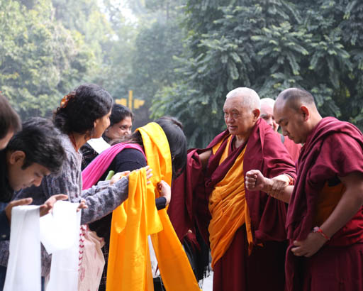 Lama Zopa Rinpoche being greeted by students, Tushita Mahayana Meditation Centre, Delhi, January 2015. Photo by Ven. Thubten Kunsang.