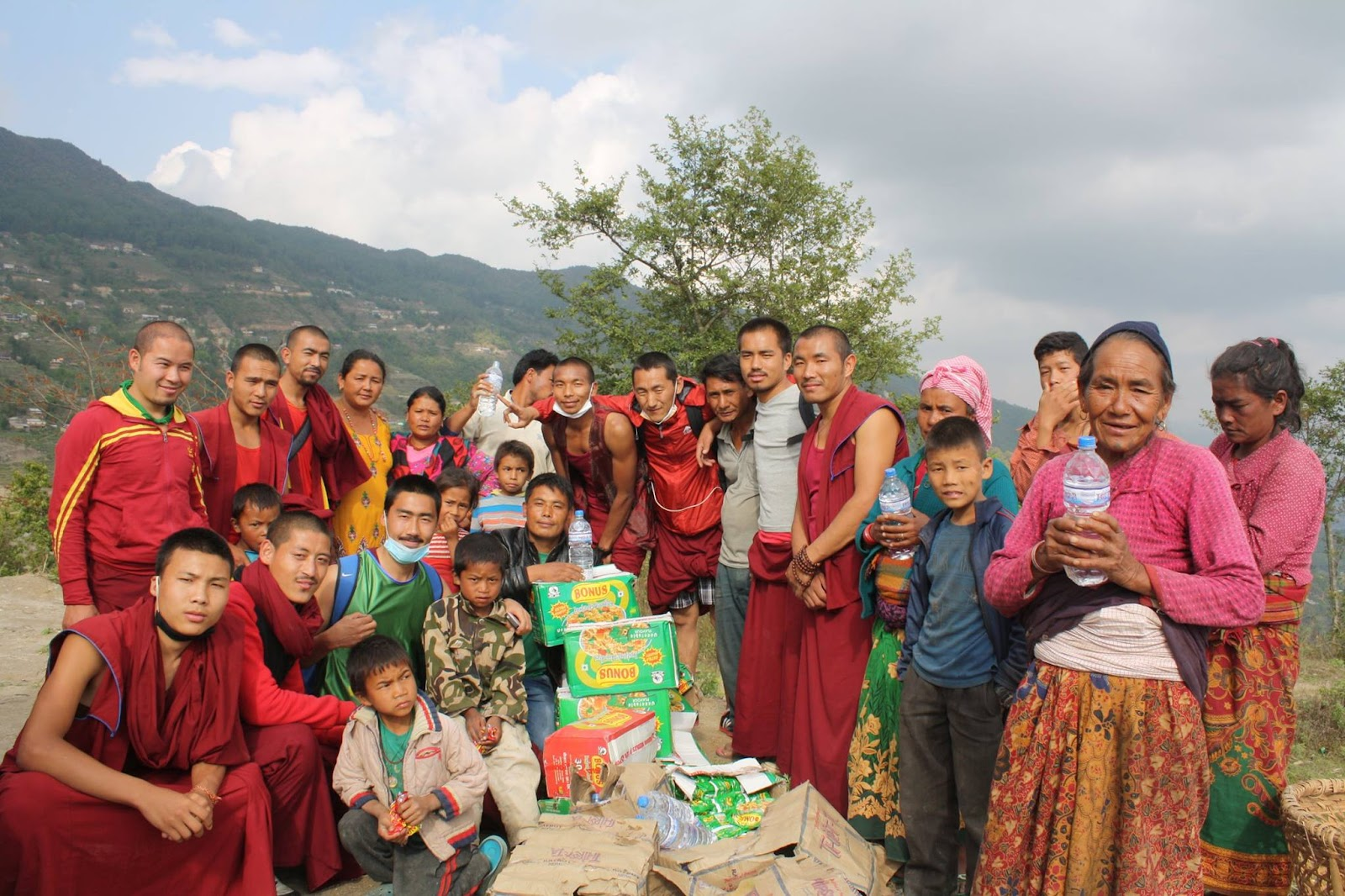Basic need supplies being offered to the worst hit areas by Kopan monks and nuns, May 2015