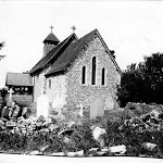 St Mary's Church. The church exterior from the south-west showing the flint-faced chancel and nave and timber bell turret, as well as some Norman survivals such as windows. Copyright © Oxfordshire County Council Photographic Archive. Reproduced with the kind permission of Oxfordshire Studies. This photograph may be purchased from their Heritage Search web site at http://www.oxfordshire.gov.uk/heritagesearch