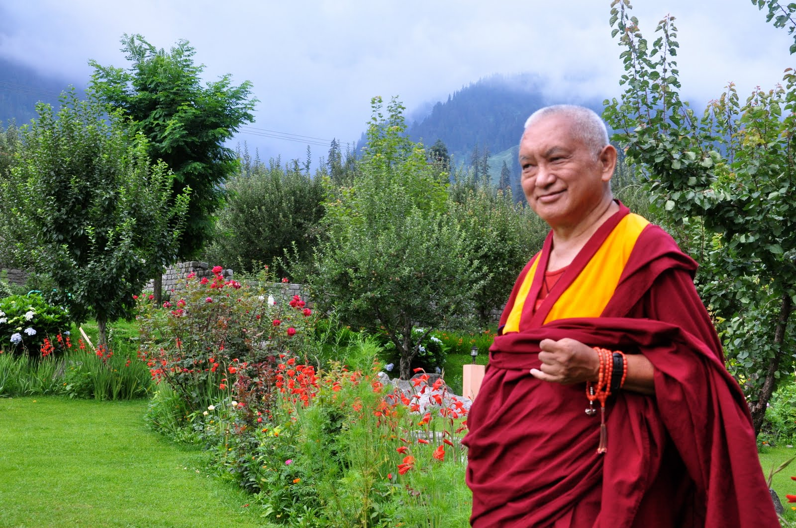 Rinpoche in Manali, India, enjoying the gardens. July, 2013. Photo Ven. Sarah Thresher.