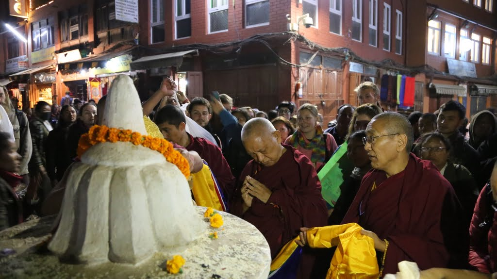Lama Zopa Rinpoche making offerings at Boudhanath, Nepal, December 2014. Photo by Ven. Roger Kunsang.