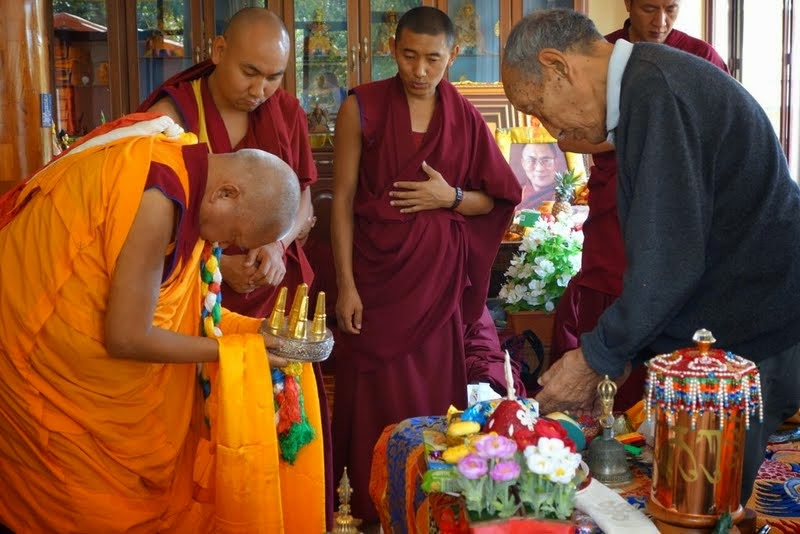 Lama Zopa Rinpoche offering a thank you mandala to Khyongla Rato Rinpoche at the end of the oral transmission of His Holiness Trijang Rinpoche's sum bum, Osel Labrang, Sera Je Monastery, India, January 2014. Photo by Ven. Roger Kunsang.