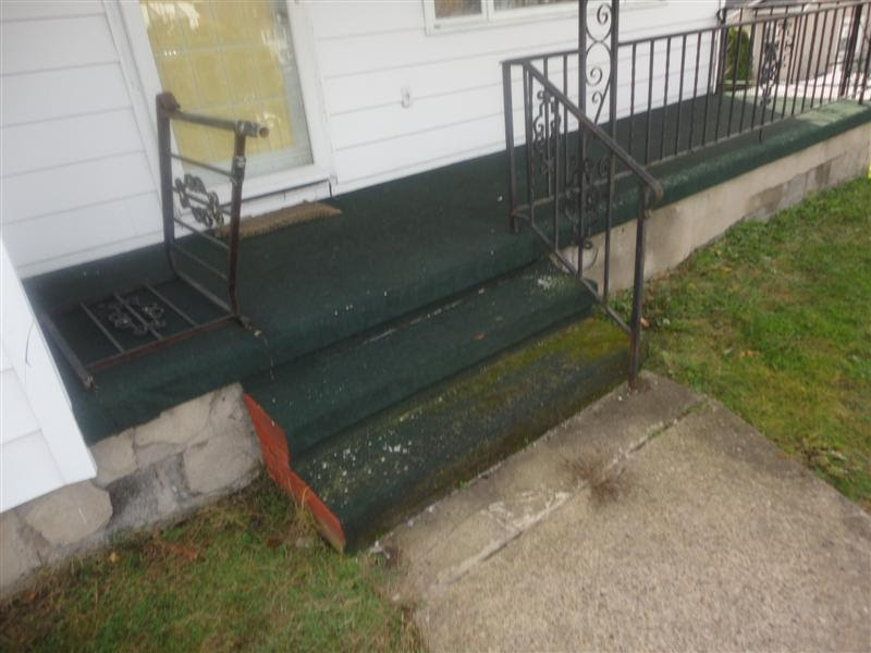 Railing down on front porch