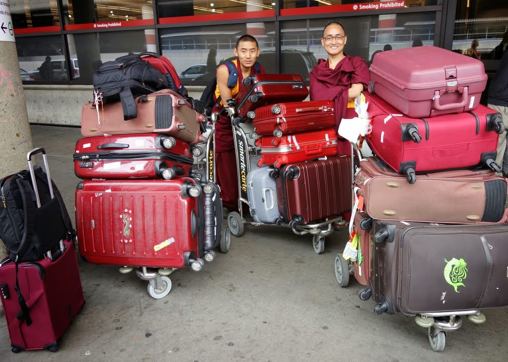 Vens. Sangpo and Sherab with the luggage, SeaTac airport, Washington, US, April 2014. Photo by Ven. Roger Kunsang. All the luggage and six people fit into one car!