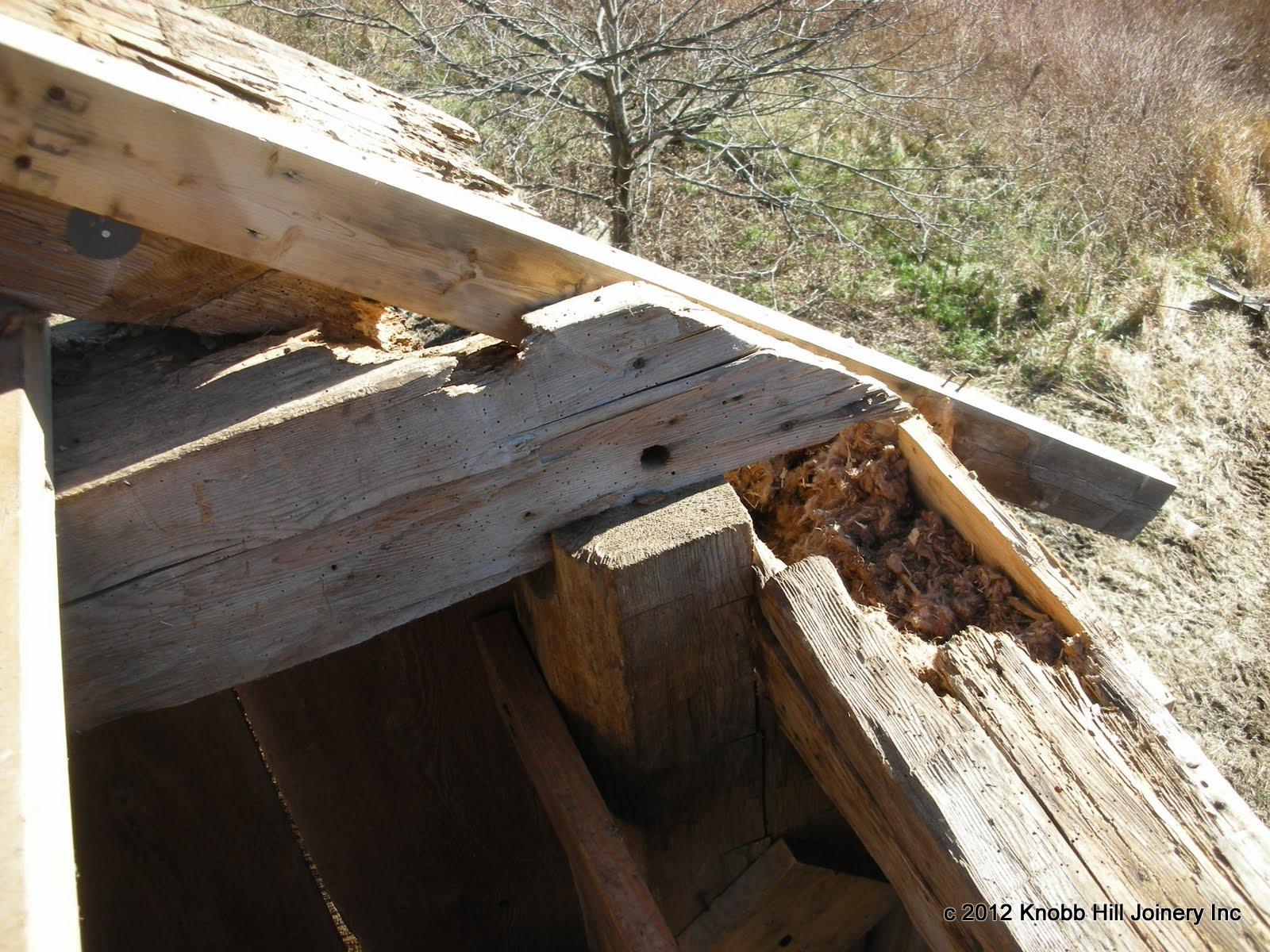 The rafter foot, tie beam, post top and plate were all destroyed at this corner post.