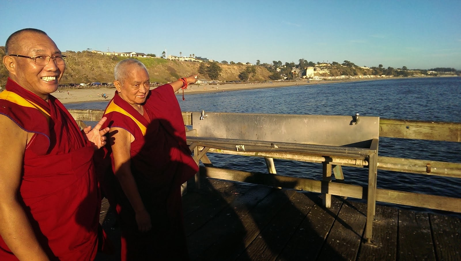 """Ven. Roger explains this photo: """"Rinpoche pointing out to Dagri Rinpoche where Lama Yeshe lived. Rinpoche's house is """"by chance"""" only a few miles away ! It wasn't planned, it just happened like that!"""" Aptos CA, Sept 2013. Photo: Ven. Roger Kunsang."""