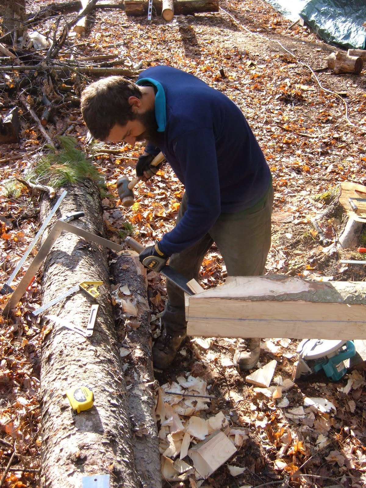Michael cuts the joinery on the foot of a new rafter.