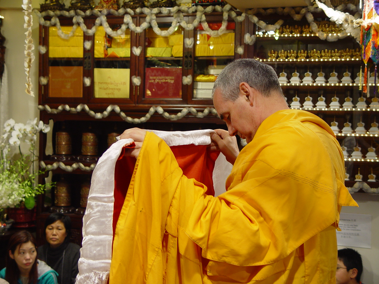 Ven.Roger Kunsang offering double vajra seat to Lama Zopa Rinpoche. Long life puja offered in Hong Kong 2004.