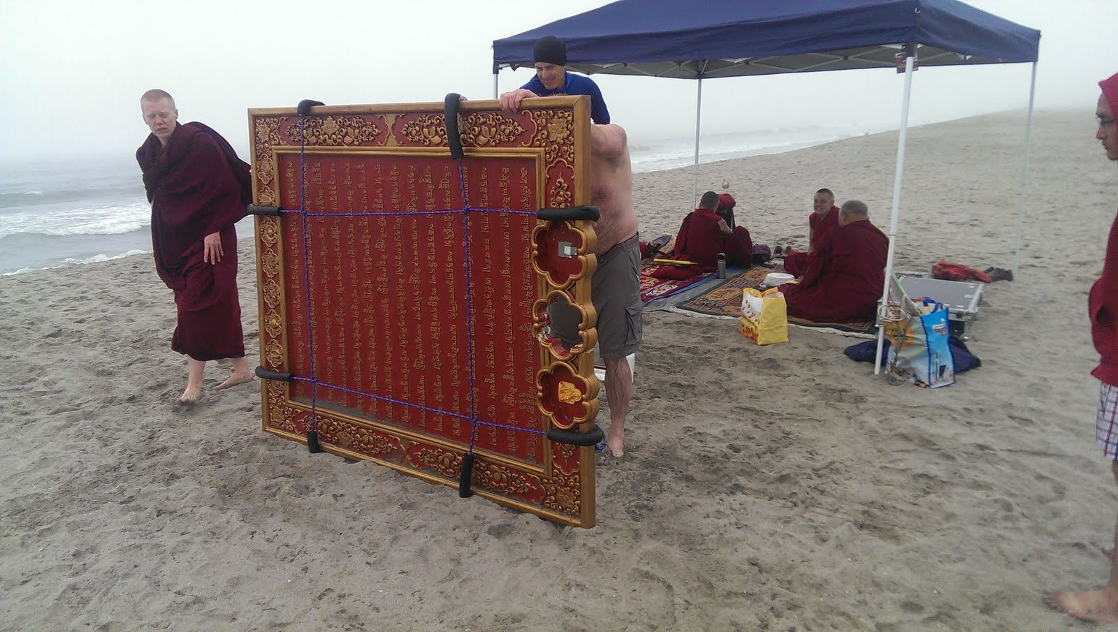 Mantra board at the beach to bless beings in the ocean.