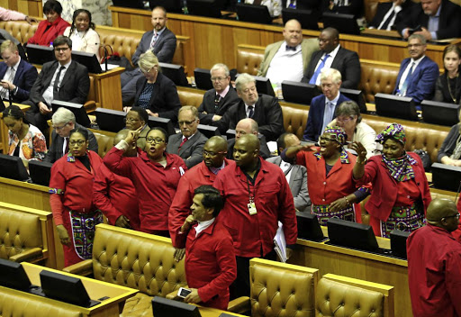 THEY WON'T SHUT UPThe EFF leaves the National Assembly during the medium-term Budget speech of Finance Minister Malusi Gigaba at parliament in Cape Town.