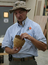 Photo: Tom Ankrum with a natural-edge persimmon bowl with a carved foot underneath.