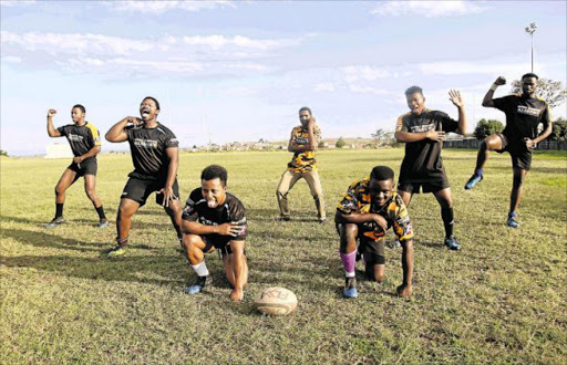 Winter Rose players and coach perform the haka at NU13 stadium after returning from an exchange programme in New Zealand. The players, from left, are: Akhona Luhabe, Luvo Bazi, Luxolo Jingqi, Songezo Sam (coach), Junior Mlonyeni, Siyavuya Matanga and Azola Mati Picture: MICHAEL PINYANA