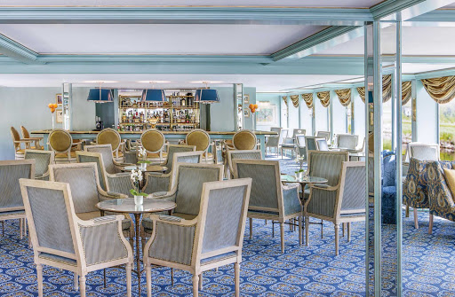 Relax in the lounge of River Empress and order a drink — it's all-inclusive.