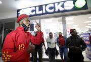 Members of the EFF blocked the entrance to the Clicks outlet in the Goodwood Mall in Cape Town.