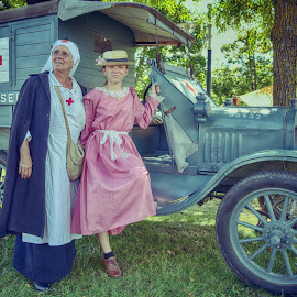 Military First Aid 100 Years ago by Marco Bertamé - People Street & Candids ( oldtimer, woman, wheel, american, girl, vehicle, red cross, vintage, nurse, 1918, first aid, france, military, verdun, hat, 1914, us, letters )