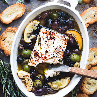 Baked Feta Cheese with Olives, Lemon and Rosemary.