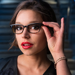 Holding Glasses by Claude Lupien - People Portraits of Women ( glasses, portraits of women, woman, red lips, lipstick, black dress, close up )