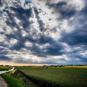 The feeling when the sun strikes through by Lars-Ove Törnebohm - Landscapes Cloud Formations ( clouds, skåne, tornephoto, landscape, sun )