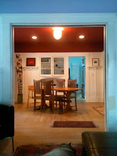 Photo: When you enter the front door into the living room (lilac color), the rooms connect straight to the back to the kitchen along the east side of the house. There are pocket doors between the living and dining room, and we have tried to rehabilitate them, but one is off the rack and it would require taking apart the moulding and doorway completely to fix it. Rose Mello Banninger, who sold us the house, told us her father used to open the pocket doors and hold dances in the living room and dining room that their friends from Davisville would come out to. Mr. Mello was a winemaker - he aged barrels of wine in the basement, which was the old farmhouse root cellar.