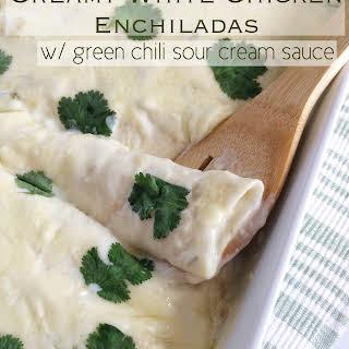 Creamy White Chicken Enchiladas w/ Green Chili Sour Cream Sauce.