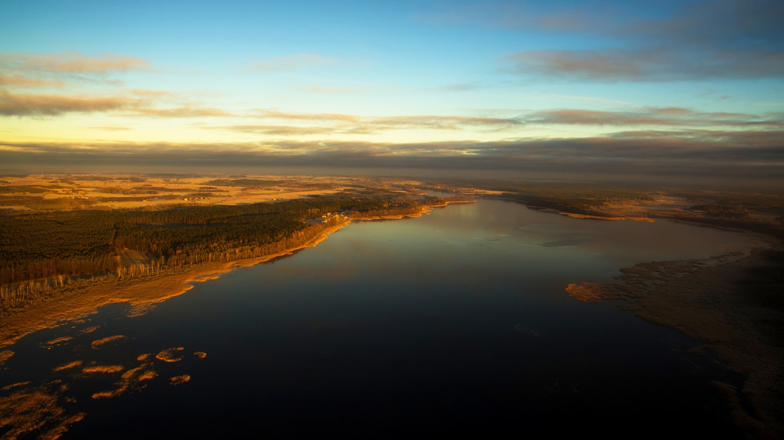 masurian lake district and forest at sunset aerial view poland nature