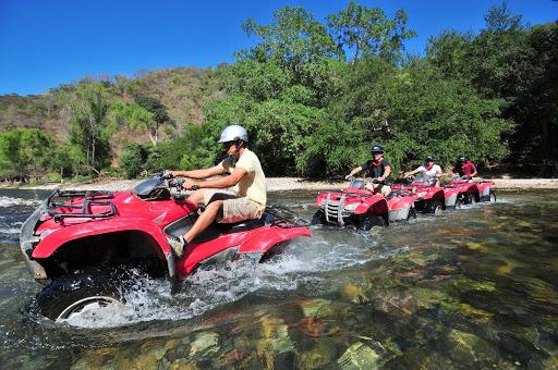 ATV-stream-Puerto-Vallarta.jpg - Visitors cross a stream on an ATV tour outside of Puerto Vallarta, Mexico.