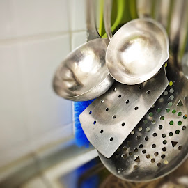 Steel ladles and colander  by Valerio Rosati - Food & Drink Cooking & Baking ( steel, appliance, spatula, objects, isolated, tools, serving, preparation, domestic, kitchenware, white, ladle, design, spoon, cooking, kitchen, nobody, group, utensil, set, skimmer, chrome, cook, work, metal, black, equipment, handle, brown, whisk, dinner, food, stainless, tool, metallic, home, fork, traditional, background, colander, household, silver, shiny, culinary, utensils, useful, wall, object )