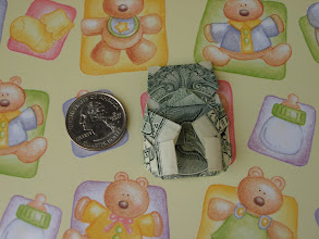 Photo: Model: Teddy Bear;  Creator: Jodi Fukumoto;  Folder: William Sattler;  1 dollar;  Publication: The Guide To American Money Folds (Jodi Fukumoto) ISBN 0-93154-870-5