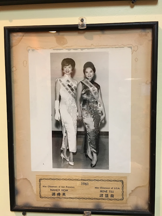 Photo from the 1961 Chinatown Beauty Pageant hanging on the wall.