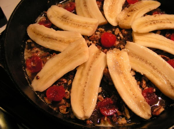 Sprinkle pecans evenly over brown sugar mixture.  Cut bananas in half crosswise; cut...
