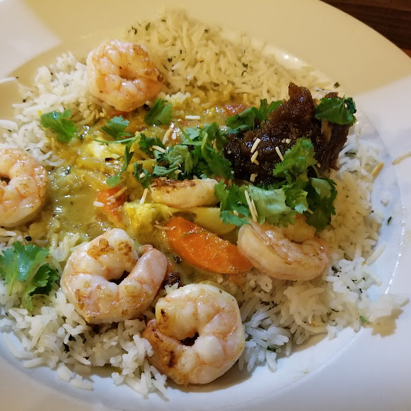 Coconut Curry (Shrimp, Chicken or Vegetarian)  Homemade coconut curry sauce, steamed veggies, homemade cumin date chutney. Topped with toasted coconut, cilantro and red onions. Available with gluten free bread.