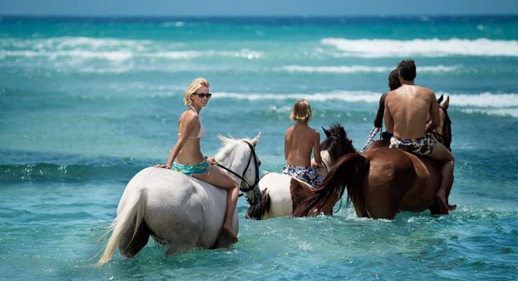 Horseback riding at Half Moon in Jamaica.