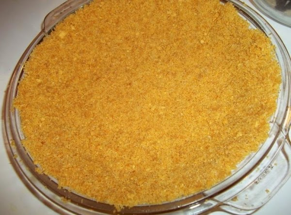 Preheat oven to 375 degree F.  Combine the cracker crumbs, sugar and butter; press onto...